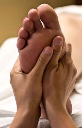 Scottish Holistiz Image showing reflexology session on foot massage..